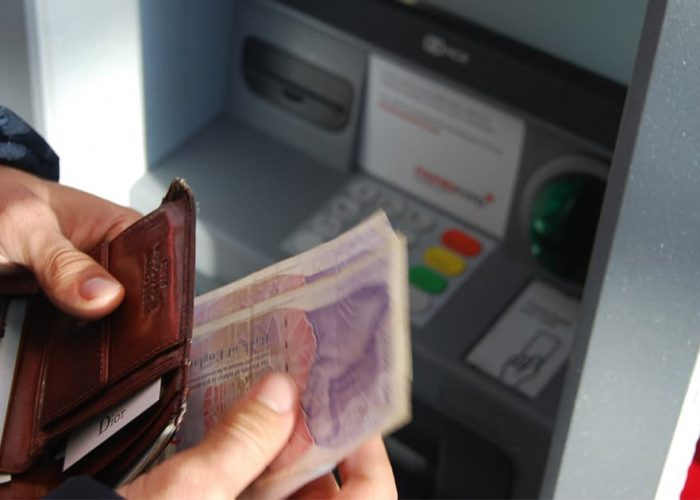 Student withdrawing cash from ATM
